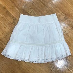 Club Monaco 100% cotton white eyelet mini skirt.